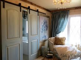 gates of crystal a new barn door in the master bedroom