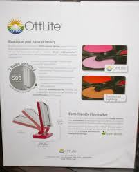 the box back it talks about the special ottlite 508 illumination lights before and after pics with and without their light technology and the depiction