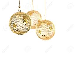 a hollow gold wire mesh christmas ornament with stars stock photo