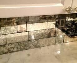 kitchen backsplash mirror antique mirror backsplash installed in different tile sizes the
