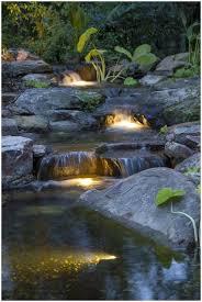 backyards impressive cascading backyard waterfall lit up at