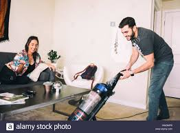 100 vacumming businesswoman vacuuming after office party