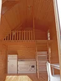 small log home interiors inspiring small log cabin decor ideas modern fabric armchair