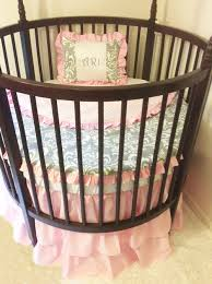 why round cribs are ideal for a small baby boy or nursery room