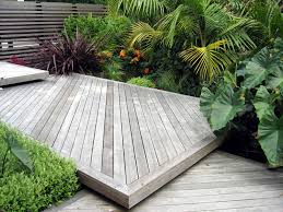 native plant landscaping ideas stepped decking screen and sub tropical planting design www