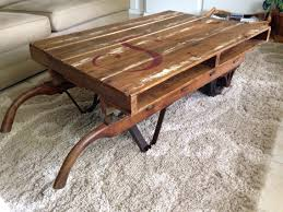 pallet table sits atop an antique hand truck clear coated and