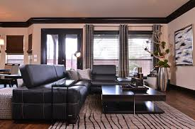 Living Room With Black Leather Furniture by Gray Leather Sofa Living Room Modern With Cabinets Wood Floor Dark