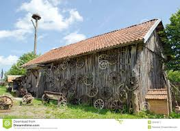 Barnhouse by Retro Carriage Wheel Barn House Bench Stork Nest Royalty Free