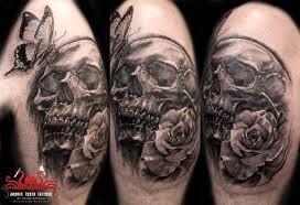 skull hatted tattoo by mehdi rasouli broken tooth tattoos broken