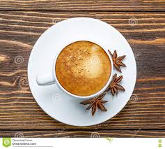 white cup of espresso on a wooden background stock photo image
