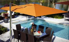 swimming pool table set with umbrella furniture white cantilever umbrella plus cozy chair and swimming