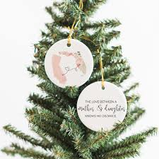 Mother Daughter Christmas Ornaments The Love Between A Mother U0026 Daughter Knows No Distance Ornament