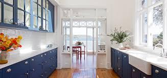 coastal kitchen floor to ceiling windows free standing oven range
