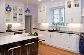 white kitchen cabinets with black countertops white kitchen with a blue kitchen stove in wilmington delaware
