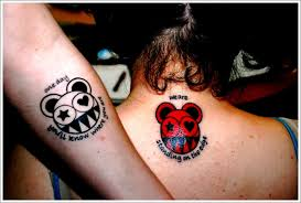 cartoon tattoo designs for couples on arm and back couples