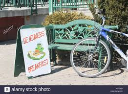 bilingual breakfast sign with bench and bike stock photo royalty