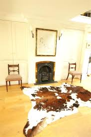 interesting faux cowhide rug on cozy pergo flooring for
