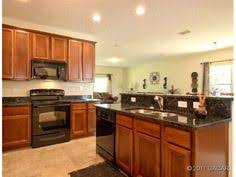 kitchens with black appliances and oak cabinets black kitchen cabinets with stainless steel appliances day