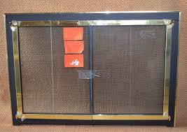 38x26 inch matte black and brass original fireplace door