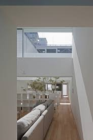 modern japanese townhouse with inner garden and podium roof