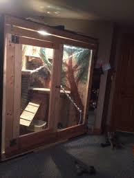 cat running into glass door iguana cage for my bedroom door built into a larger door on the