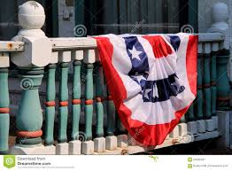Country American Flag American Flag Draped Over Railing Of Country Home Stock Image