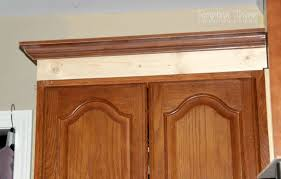 how to add crown moulding to cabinets adding height to the kitchen cabinets tempting thyme