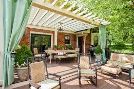deck with pergola and outdoor curtains