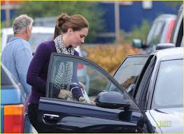 kate the duchess of cambridge loads her car after shopping at