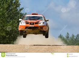 orange subaru impreza orange sport car subaru impreza jumps at rally editorial stock
