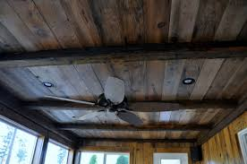recycled log home logs and barn board for this sun room addition