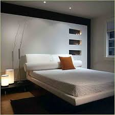 bedroom small bedroom with recessed cabinet and white bed cover