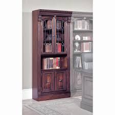 dark brown wooden bookshelf with double glass sliding doors and