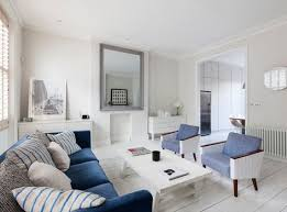 livingroom in livingroom in notting hill maisonette with large mirror blue