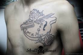 23 guitar tattoos on chest