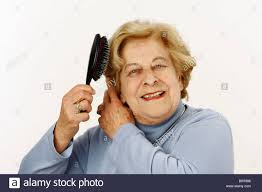 old hair at 59 old woman 80 years old brushing her hair stock photo 31464502 alamy
