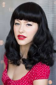pinup clip in ponytail with bangs black wig curled with short fringe bettie mid length wigs