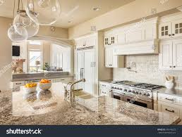beautiful new kitchen interior island sink stock photo 245146273 beautiful new kitchen interior with island sink cabinets and pendant lights in new home