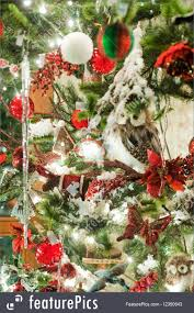 picture of christmas decorations hanging in green xmas tree