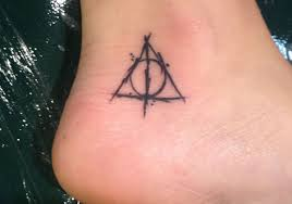 cool small deathly hallows tattoo on ankle