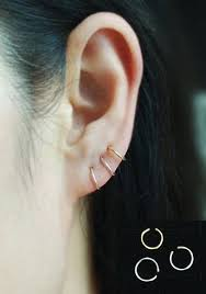 tight hoop earrings best 25 cartilage ring ideas on cartilage piercings