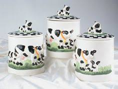 themed kitchen canisters betsy farm kitchen cow apples wall decor clock in the home