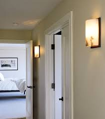 splendid modern hallway lighting idea using yellow wall sconces
