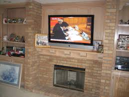 rustic exposed brick fireplace mantle with wall mount tv and