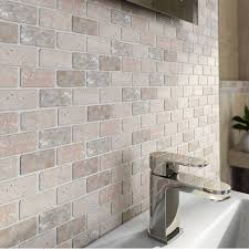 mosaic brick style wall tiles set the perfect scene for bathroom