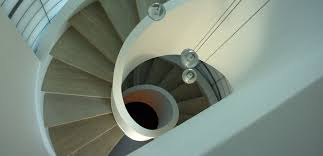 beautiful spiral staircase painted and refinished