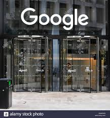 doors to google offices with sign above revolving entrance door to