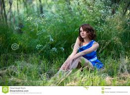 beautiful young sitting in a forest glade stock photo image