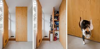 Wooden Storage Closet With Doors This Storage Closet Has A Cat Shaped Opening So The Cat Can Reach