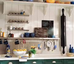 small kitchen storage open shelves and hooks under wooden shelf